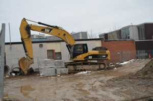 A backhoe digs away at the site of a soon-to-be all-Kindergarden facility at Thorncliffe Public School.