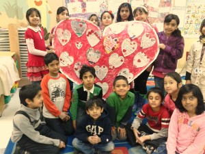 "Children pose with their finished poster at TNOYC's Valentine's Day ""Have A Heart"" party."
