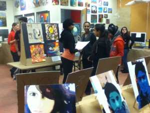 Students gather to examine and appreciate their peers' artwork.