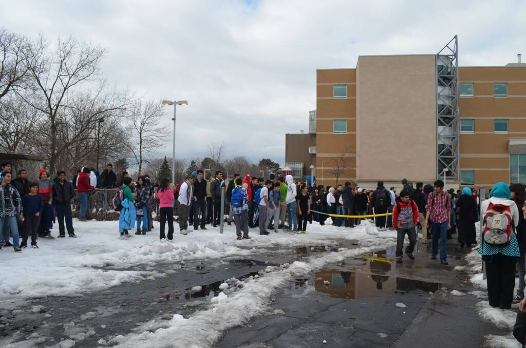 Crowds of students outside MGCI during a false fire alarm incident. Photo: Sabrina Bertsch