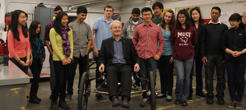 Dr. Garneau poses with members of MGMT and SAC while sitting on the Moonbuggy. Photo: Mahan Nekoui
