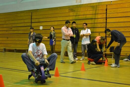Students drive through an obstacle course while wearing impaired goggles.