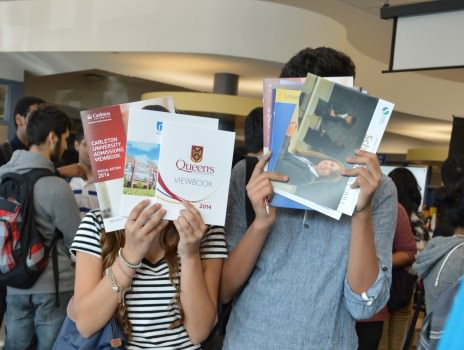 Garneau Students received many university handbooks during the fair. Photo: Khadija Aziz