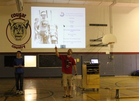 Henry He and Mr. Fox give  a presentation about Terry Fox before students participate in the walk.  Photo: David Tang.