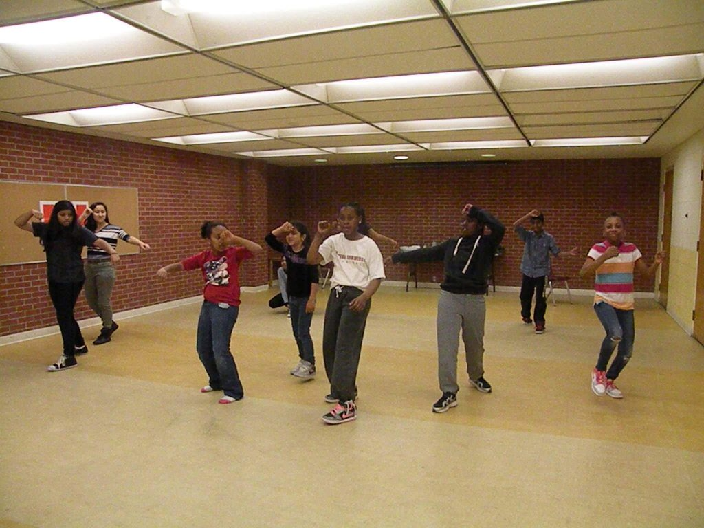 Marc Garneau students dance with kids from the dance club at Flemingdon library.