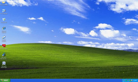 The familiar Windows XP desktop is still one commonly found running throughout corporations and school boards alike. (Image courtesy of Archive Team)