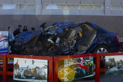 A wrecked car was placed on display.  Photo: Cindy Cui