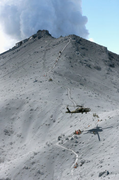 Search and rescue missions in progress at the peak of mount Omake for possible survivors. (Image courtesy of Kyodo News.)