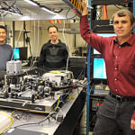 Eric Betzig and his colleagues beside the light lattice microscope. (Image courtesy of Howard Hughes  Medical Institute)