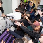 People crowd to get electronic devices in London on Black Friday. (Image courtesy of David Parry/AP Photo)