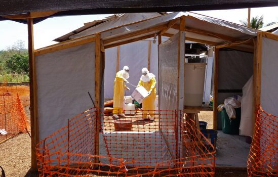 Ebola treatment workers in New Guinea during the the construction of treatment centres in early March.  (Courtesy of The Columbian.)