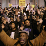 People protest decision made by the grand jury to not indict police officer Darren Wilson. (Image courtesy of Chip Somodevilla/Getty Images)