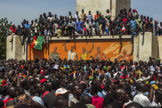 Citizens of Burkina Faso gather for the announcement of a new leader on Saturday morning.
