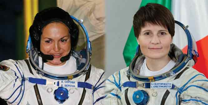 Female astronauts Cristoforetti and Serova pose for their pictures as astronauts soon to board the ISS.