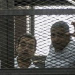 Egyptian courts have released Baher Mohamed (left) and Mohamed Fahey (right) on bail. (Image courtesy of Khaled Desouki/Agence France-Presse — Getty Images)