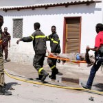 Emergency workers carry away a wounded person from an attack that has already killed 15 people in Mogadishu, Somalia. (Image courtesy of Feisal Omar/Reuters)