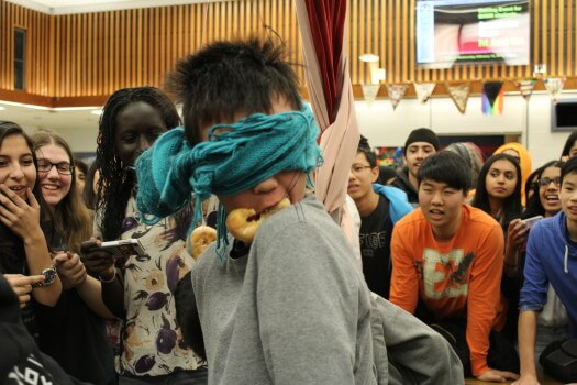 Students were blindfolded during their donut-eating attempt. Photo: Khadija Jawwad