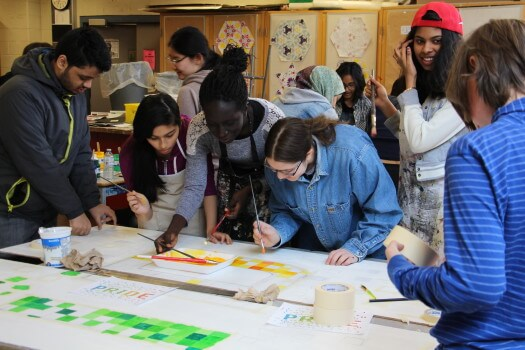 Students from the QSA and MGCI's Art Council collaborated to create a mural to be placed in the school cafeteria. Photo courtesy of Gloria Zhou