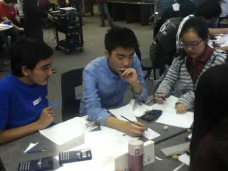 Students worked as a team to solve math problems for the tournament. Photo: Lily Song