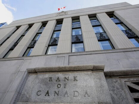 The Bank of Canada lowers interest to 'mitigate' the loss from the drop in oil prices. (Image courtesy of Patrick Doyle/Bloomberg.)