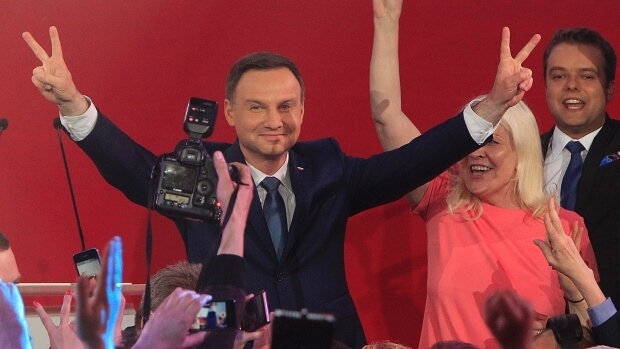 Andrzej Duda addressed a crowd of supporters in Warsaw after exit polls were released. (Image courtesy of Czarek Sokolowski/Associated Press.)