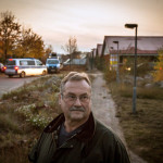 The mayor of Sumte, Christian Fabel, stands in front of a facility for the refugees.