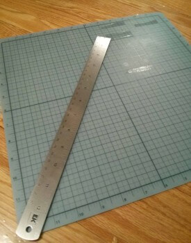 This mat came with a craft knife at WalMart for about $15. It's useful for cutting paper as well, if you ever need it for other projects.