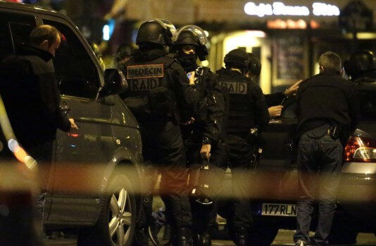 Police officers man a position close to the Bataclan theatre on November 13, 2015 after a series of gun attacks occurred across Paris as well as explosions outside the national stadium where France was hosting Germany. A number of people were killed and others injured in a series of gun attacks across Paris on Friday, as well as explosions outside the national stadium where France was hosting Germany. AFP PHOTO /KENZO TRIBOUILLARD (Photo credit should read KENZO TRIBOUILLARD/AFP/Getty Images)