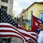 Cuban resident waving the cuban flag. Source: National Post.