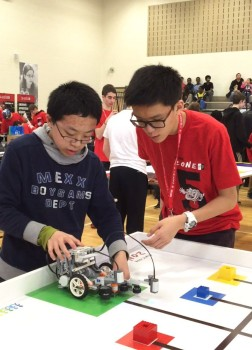 The Marc Garneau Machines looking over their robot. (Photo courtesy of Kai Huang)