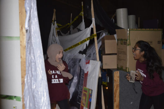 A Spirit Committee volunteer scares a student in the haunted house. Photo: Cindy Cui